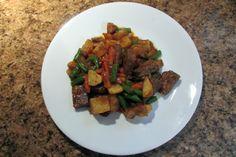 A simple one pan beef brisket, veggie and tators in dark gravy.