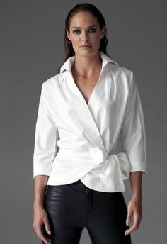 https://www.cityblis.com/6074/item/12541 | ABIGAIL WHITE - $121 by The Shirt Company | With its shaped 3/4 sleeves and x-over front the Amelia shirt will effortlessly update your late summer wardrobe. Flattering on most figures and great on a bust.  The tie clinches in the waist and finishes with a generous bow.  Wrap Around Shirt with Bow Tie 96% Cotton/ 4% Elastane - Cotton Sate... | #Tops/Blouses