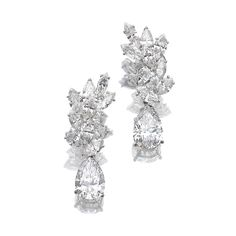 Attractive Pair of diamond pendent ear clips Each cluster surmount set with marquise-shaped diamonds, suspending a detachable pear-shaped diamond drop weighing respectively 5.17 and 5.04 carats.