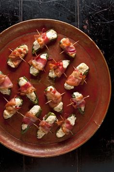 Bacon-Wrapped Jalapeño Poppers by Saveur. This addictive finger food is a perfect marriage of textures and flavors: creamy, chive-flecked cheese cuts the bite of roasted jalapeños, while crispy bacon adds crunch. Jalapeno Popper Recipes, Bacon Wrapped Jalapeno Poppers, Bacon Recipes, Cooking Recipes, Saveur Recipes, Catering Recipes, Free Recipes, Holiday Party Appetizers, Finger Food Appetizers
