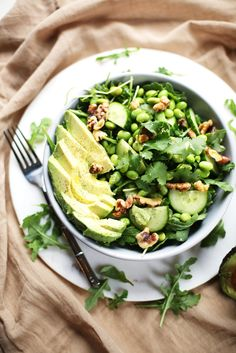 This simple, refreshing green salad bowl will leave your taste buds feeling happy.