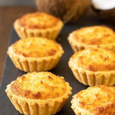 My take on the delicious Hong Kong style coconut tarts. The pastry is super flaky. The filling is mostly coconut (yum!) and it's not overly sweet. Asian Desserts, Mini Desserts, Sweet Desserts, Just Desserts, Delicious Desserts, Plated Desserts, Lemon Desserts, Pastry Recipes, Tart Recipes