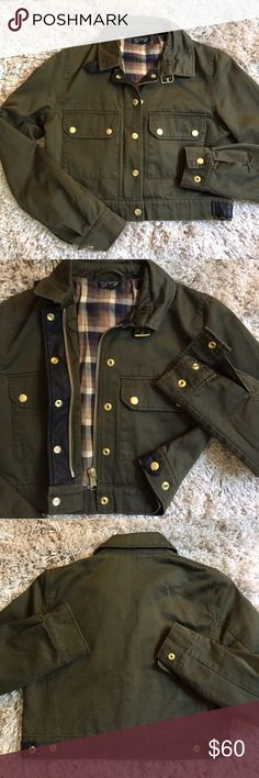 Topshop Military Cropped Jacket + Great condition. + Plaid lining 🍂🍃 Perfect for fall!  + Gold buttons and zipper accents  + Two front pockets  + Buckle collar    + Don't forget to bundle with other Topshop items  ⭐️All items are steamed cleaned and shipped within 48 hours of your purchase. ⭐️If you would like any additional photos or have any questions please let me know. ⭐️Sorry, no trades. But will listen to ALL fair offers. Thanks for shopping! Topshop Jackets & Coats