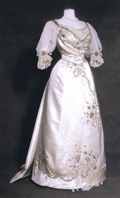 An embroidered silk evening gown made circa 1890, from the Olive Matthews Collection at the Chertsey Museum in Surrey, UK.