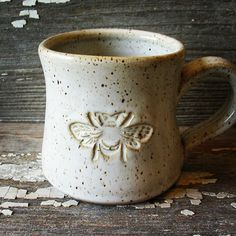 Mug - Handmade Pottery Bee Mug - White Bee Mug - Tea Cup - Bee Coffee Cup - Honey - Honeybee - Beekeeper - IN STOCK now! IN STOCK & READY TO SHIP! Cozy up and sip your coffee, tea or favorite soup out of this sturdy hand made cup, or make it a unique gi Stoneware Mugs, Ceramic Cups, Ceramic Art, Pottery Mugs, Ceramic Pottery, Pottery Gifts, Slab Pottery, Thrown Pottery, Pottery Ideas