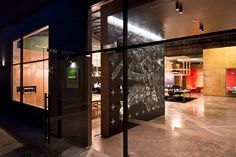 This Modern Office Entrance Features Many Different Materials