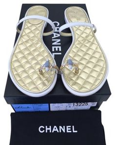 Get the must-have sandals of this season! These Chanel White 2015 Cc Logo Jeweled Toe Ring Quilted Flat Sandals Size US Regular (M, B) are a top 10 member favorite on Tradesy. Chanel Sandals, Chanel Shoes, Chanel 2015, White Sandals, Toe Rings, Gold Hardware, Gold Gold, Jewels, Flats