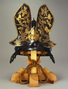 x x x ~ `Tokugawa Clan Crest Kabuto.The Mon / crest of the Tokugawa Clan, the 'triple hollyhock'. Any helmet painted with butterfly and dragonfly design can usually be associated with Tokugawa. Ronin Samurai, Samurai Weapons, Samurai Helmet, Helmet Armor, Samurai Armor, Arm Armor, Japanese Warrior, Japanese Sword, Japanese Art