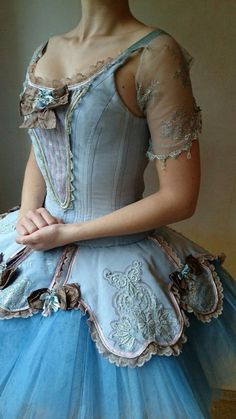 note how the sheer sleeves are not attached. this seems to be a ballet costume