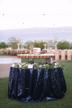 Look at Ohco for cranberry and navy sequin fabrics to use as tablecloths