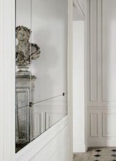Classical Parisian interior with mirrors and moldings, the Balmain store by Joseph Dirand _