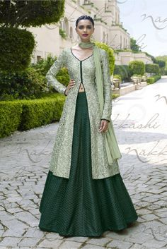 Green front slit Lehenga style suit with resham embroidery Green poly silk embroidered Lehenga style Resham embroidery with golden gotta border on Comes with matching santoon bottom and chiffon Can be stitched upto size 42 inches Long Choli Lehenga, Green Lehenga, Silk Lehenga, Designer Party Wear Dresses, Indian Designer Outfits, Indian Gowns Dresses, Pakistani Dresses, Indian Attire, Indian Outfits