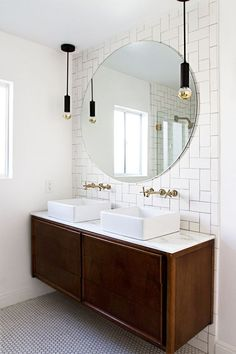 floating vanity, square sinks, round mirror, full tile wall, decorative pendants