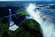 Victoria Falls, separating Zambia and Zimbabwe, rafted the Zambezi below it with crocodiles, and walked & swam along the edge of the falls.