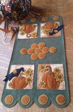 Wool applique & embroidery penny rug for Fall. Pumpkin Harvest Table Runner Pattern CPD-180 by Cath's Pennies Designs - Cathy Wagner. Check out our wool patterns. https://www.pinterest.com/quiltwomancom/wool/ Subscribe to our mailing list for updates on new patterns and sales! https://visitor.constantcontact.com/manage/optin?v=001nInsvTYVCuDEFMt6NnF5AZm5OdNtzij2ua4k-qgFIzX6B22GyGeBWSrTG2Of_W0RDlB-QaVpNqTrhbz9y39jbLrD2dlEPkoHf_P3E6E5nBNVQNAEUs-xVA%3D%3D