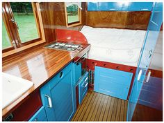 Blue and red camper