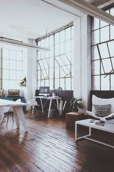 Love this office with tall ceilings and old factory windows. I can't wait to have a studio in a remodeled industrial building. Distinguished Company