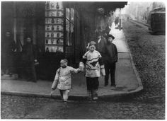Two girls crossing the street in Chinatown, ca. 1900.  Photo by Arnold Genthe.
