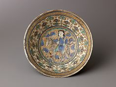 "Bowl, Mina'i (""enameled"") ware    Date:      early 13th century  Culture:      Iran  Medium:      Composite body, stain- and overglaze-painted, and gilded; decoration molded in relief  Dimensions:      Diameter: 11 3/4 in. (30 cm.)  Classification:      Ceramics"