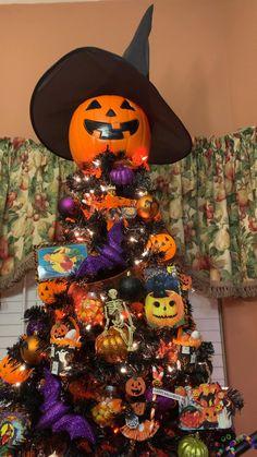 A black Walmart Christmas tree becomes a classic Halloween Witch tree. Walmart Christmas Trees, Halloween Christmas Tree, Halloween Circus, Black Christmas Trees, Outdoor Halloween, Halloween Town, Holidays Halloween, Halloween Pumpkins, Halloween 2020