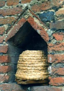 special niches, called bee boles, built into walls to hold bee skeps