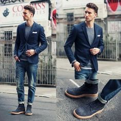Shop this look for $165:  http://lookastic.com/men/looks/blazer-and-desert-boots-and-pocket-square-and-crew-neck-sweater-and-jeans-and-crew-neck-t-shirt/1883  — Navy Blazer  — Navy Suede Desert Boots  — White Pocket Square  — Grey Crew-neck Sweater  — Navy Jeans  — White Crew-neck T-shirt