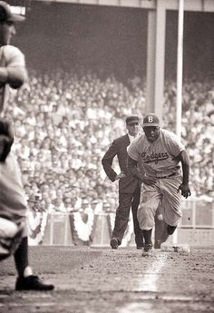 Jackie Robinson (1919-1972) - an American baseball player who, (in April of 1947), became the first African American to play in Major League Baseball. By 1949, he had  won the National League Most Valuable Player Award.