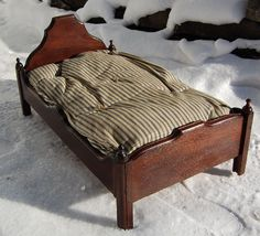 Early Walnut Doll Bed with Blue Ticking Mattress