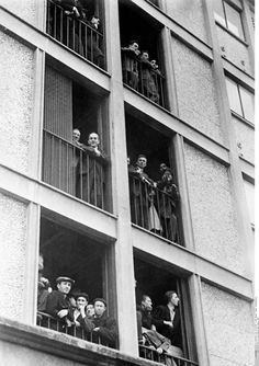 Drancy, France, Jews looking out the windows of a building used as a concentration camp, 1941.
