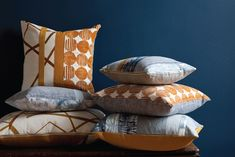 Rebecca Atwood - Pillows with brass zippers and mixed prints