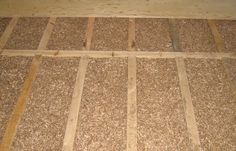 """Loose hemp floor insulation - """"Hemp offers the benefits of a lightweight material which offers superb sound insulation.  Carbon is stored in the cellulose making this material better than zero carbon.  It is important to fully fill the space between the joists to avoid sound bouncing through the timbers."""""""