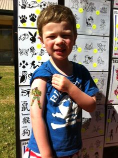 How cute is this lil' Ninja Turtle fan, with a Ninja Turtle Airbrushed tattoo. Awe!