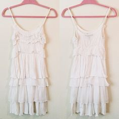 Layered White Dress This white dress looks cute with wedges. It's stretchy and extremely comfortable. 70% Rayon, 30% Polyester.  ✅Reasonable offers welcome! ✅BUNDLE DISCOUNTS! No trades/paypal/other apps. No lowball offers. Love Stitch Dresses