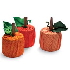 Easy to make pumpkin decorations.Take full toilet paper rolls and place in center of 18 x 22 inches. Pull up and tuck into toilet paper. Stem is rolled up piece of paper bag with green pipe cleaner and leaf attached. Poke into top of toilet paper roll.
