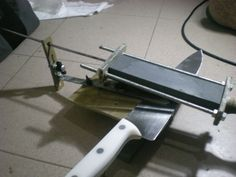 Knife Sharpening Jig by matosmeister -- Homemade knife sharpening jig featuring a grinding angle regulator adjustable between 15 - 25 degrees. Intended to accommodate standard sharpening stones. http://www.homemadetools.net/homemade-knife-sharpening-jig-3