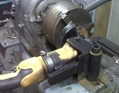 Lathe Grinder Mount by fredschrom -- Homemade lathe grinder mount constructed from steel plate, steel bar stock, and a hose clamp. http://www.homemadetools.net/homemade-lathe-grinder-mount