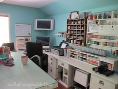 I love looking at scrapbooking rooms.....someday I will have one