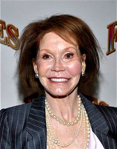 Mary Tyler Moore...hardly recognizable after too much plastic surgery.