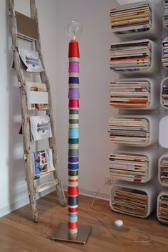 Yarn spools on HEMMA floor lamp base by mommo design