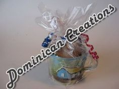 Gift wrapped tin mug filled with assorted  candies. Can be packaged with Santo Domingo coffee.