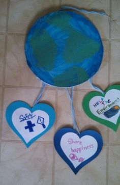 For the World of Girls journey, badge, our Brownies created mobiles with three ideas of how we can make a better world for girls. Earth is foam core sponge painted. Hearts are card stock. Yarn to hang. Girl Scout Law, Scout Mom, Daisy Girl Scouts, Girl Scout Leader, Girl Scout Brownie Badges, Brownie Girl Scouts, Girl Scout Cookies, Girl Scout Activities, Activities For Girls