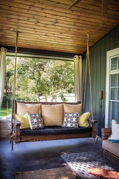What could be more complimentary to an entryway patio than a wooden porch swing? Bring back the charitableness of times past. A porch swing can add a dash of sentimentality to the front of your home. Farmhouse Front Porches, Modern Farmhouse Exterior, Rustic Porches, Southern Front Porches, Interior Exterior, Exterior Design, Outdoor Spaces, Outdoor Decor, Outdoor Living