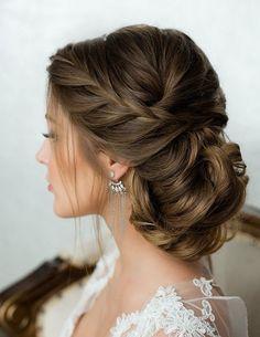 braided hair in low bun wedding hairstyle | wedding hair | more bridal inspiration & wedding inspo @danellesbridal danellesboutique.com