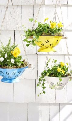 Hang spring flowers in brightly colored colanders for an unexpected and truly unique way to update your porch.