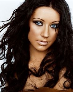 Love the tan, the hair color and the nose piercing.