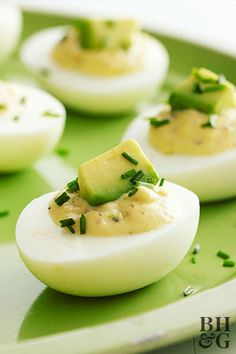 Avocado met eggs, and appetizers will never be the same. These extra-creamy deviled eggs aren't too rich thanks to fresh lemon juice and capers. Bhg Recipes, Snack Recipes, Cooking Recipes, Healthy Recipes, Snacks, Healthy Food, Recipies, Southern Deviled Eggs, Best Deviled Eggs