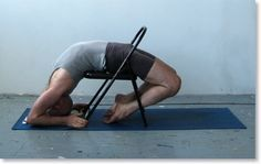 Kapotasana (pigeon pose) over a chair, in the tradition of Iyengar Yoga