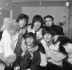 The Beatles in the dressing room with their road manager, personal assistant and driver Neil Aspinall. Christmas Show 1964 at the Hammersmith Odeon.