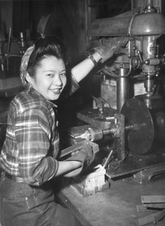"40s workwear casual jeans Asian American ""Miss Ethel Mildred Lee, 23-year-old girl born in this country of Chinese parents, is shown at her job as an electrician-helper at the Los Angeles yards of the California Shipbuilding Corporation, where she has worked for almost two years. Extra incentives to help the war effort are two brothers in the U.S. Army and one in the Navy yard at Honolulu, Hawaii. Miss Lee buys $ 100 worth of War Bonds a month."" January 1944 - WWII propaganda photograph USA…"