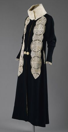 Coat, ca. 1919 Black silk and wool blend with white leather appliqués and white fur trim Gift of Mrs. David J. Colton, 1961 (C.I.61.40.4)